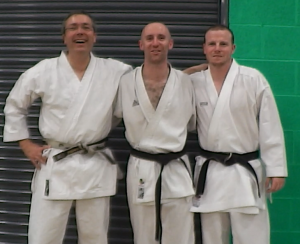 Image of Ruach Karate club group photo at Paul Campbell's open karate competition at Ellowes Hall School in Sedgley. (Left to right: Dave Farrance, Matt Cromwell, Russell Dobbins)